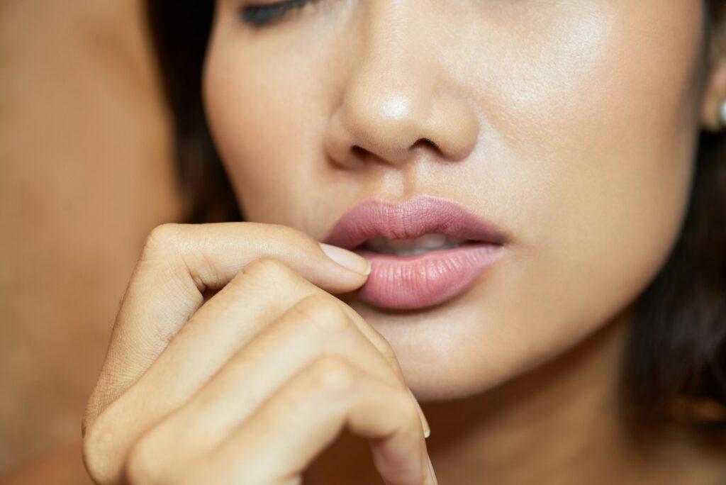 Sensual Young Woman with Plump Lips